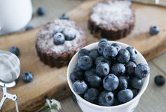 Blueberries with brownies in background stock photo