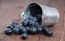 Blueberries in a bucket on wood Stock Image