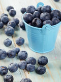 Blueberries in a bucket on a wooden table. Royalty Free Stock Photos