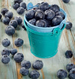 Blueberries in  buckets on  wooden table. Stock Images