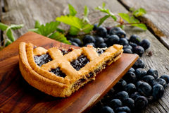 Blueberries cake. On wood dish  over wood table Stock Image