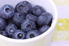 Blueberries in a ceramic tub - Left view. A bunch of fresh blueberries in a ceramic tub Stock Photo