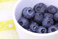 Blueberries in a ceramic tub - Right view. A bunch of fresh blueberries in a ceramic tub Stock Photos