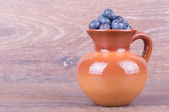 Blueberries in a clay jug Stock Photo