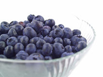 Blueberries in a Clear Bowl. Isolated on white Stock Photos