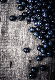 Blueberries collected manually scattered on the old board Royalty Free Stock Image