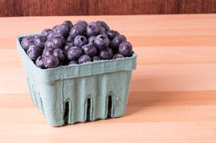 Blueberries in container on table Royalty Free Stock Photos