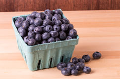 Blueberries in container and on table Stock Image