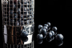 Blueberries in cup strainer from side Royalty Free Stock Photography