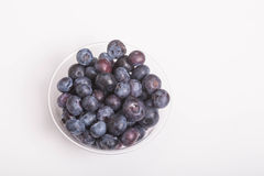 Blueberries in Cup on White Royalty Free Stock Photo