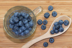 Blueberries. In a cup on wooden desc. Wooden cup with some berries Royalty Free Stock Photos