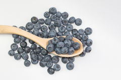 Blueberries. In a cup on wooden desc. Wooden cup with some berries Stock Photo