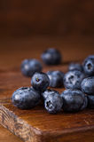 Blueberries on a cutting board Royalty Free Stock Photo