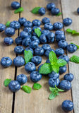 Blueberries decorated with mint Royalty Free Stock Image