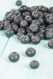 Blueberries. Delicious juicy  on a blue wooden table Stock Photos