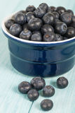 Blueberries. Delicious juicy  on a blue wooden table Royalty Free Stock Photo