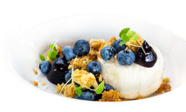 Blueberries dessert. Blueberries on almond cake with roasted almond parfait and pickled ginger Stock Photography