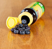 Blueberries in drug bottle Royalty Free Stock Photo