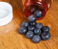 Blueberries in drug bottle Stock Photo