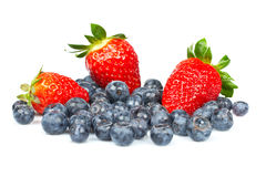Blueberries and fresh tasty strawberries Royalty Free Stock Photography