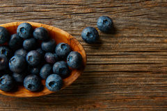 Blueberries fruits on a wooden board table Royalty Free Stock Photos