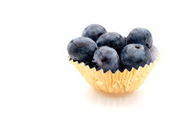 Blueberries in a gold foil cup Stock Photography