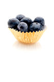 Blueberries in a gold foil cup Royalty Free Stock Image