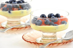 Blueberries, grapefruit and lemon yogurt Royalty Free Stock Photos