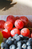 Blueberries and grapes Stock Photos