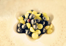 Blueberries and green grapes Stock Photography