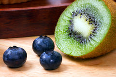 Blueberries and half of kiwi Royalty Free Stock Image