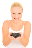 Blueberries in the hands Royalty Free Stock Image