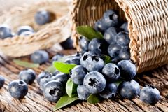 Blueberries have dropped from the basket Royalty Free Stock Photos