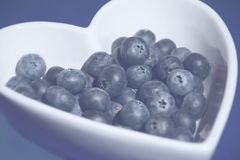 Blueberries in heart shaped bowl royalty free stock photos