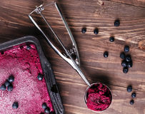 Blueberries ice-cream. Homemade blueberry ice-cream on the wooden table, up view Royalty Free Stock Images