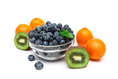 Blueberries, kiwi and tangerines on a white background Stock Images