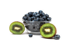 Blueberries and kiwi on a white background Royalty Free Stock Images