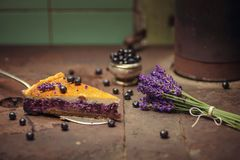 Blueberries and lavander cheesecake served on oven with berries and flowers, still life for patisserie, healthy cake Royalty Free Stock Photos