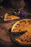 Blueberries and lavander cheesecake served on oven with berries and flowers, still life for patisserie, healthy cake Royalty Free Stock Image