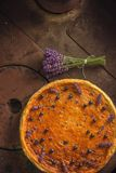 Blueberries and lavander cheesecake served on oven with berries and flowers, still life for patisserie, healthy cake Stock Photos