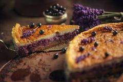 Blueberries and lavander cheesecake served on oven with berries and flowers, still life for patisserie, healthy cake Stock Image
