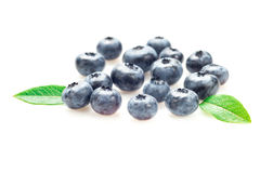 Blueberries with leaves on white background. Some blueberries isolated on white royalty free stock photography