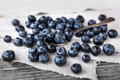 Blueberries lie on a homespun tablecloth and in metal spoon. Royalty Free Stock Photo