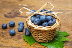 Blueberries in a little basket stock image