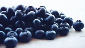 Blueberries Lot Above Beige Wooden Surface stock photography