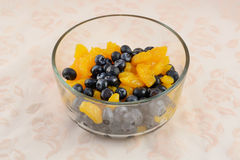 Blueberries and mandarin oranges. Simple fruit salad of fresh blueberries and canned mandarin oranges in glass bowl Royalty Free Stock Images