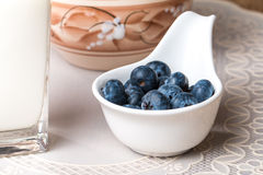 Blueberries and milk products on wooden table Stock Photography