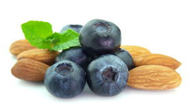 Blueberries with mint and almonds. Close up Royalty Free Stock Photos