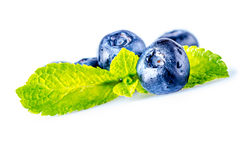 Blueberries and mint. Blueberries and green mint leaves on the white background Royalty Free Stock Photos