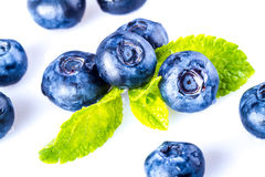 Blueberries and mint. Blueberries and green mint leaves on the white background Stock Photo
